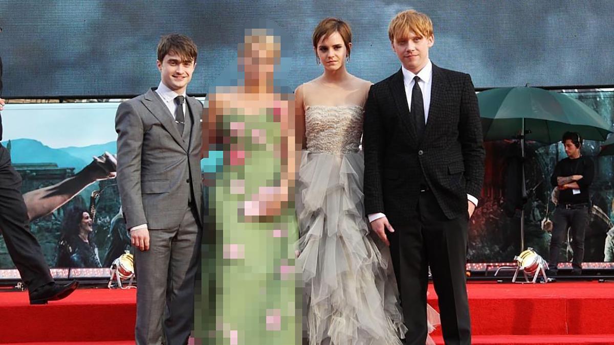Daniel Radcliffe, a blurred figure, Emma Watson, and Rupert Grint at a Harry Potter premier